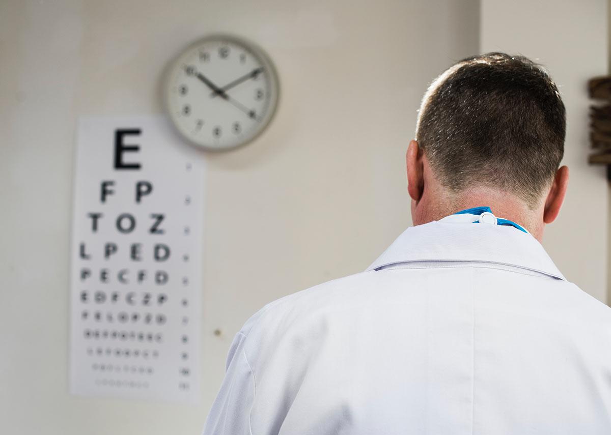 optometrist with eye chart