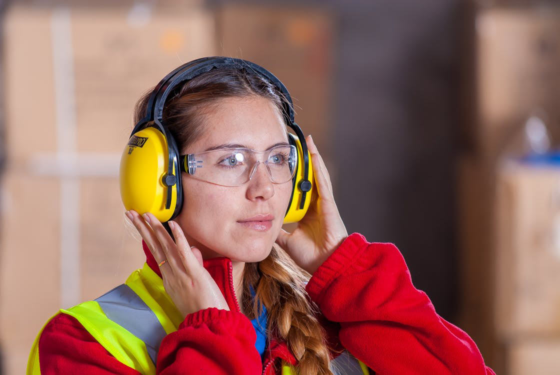 woman wearing googles and hearing protection