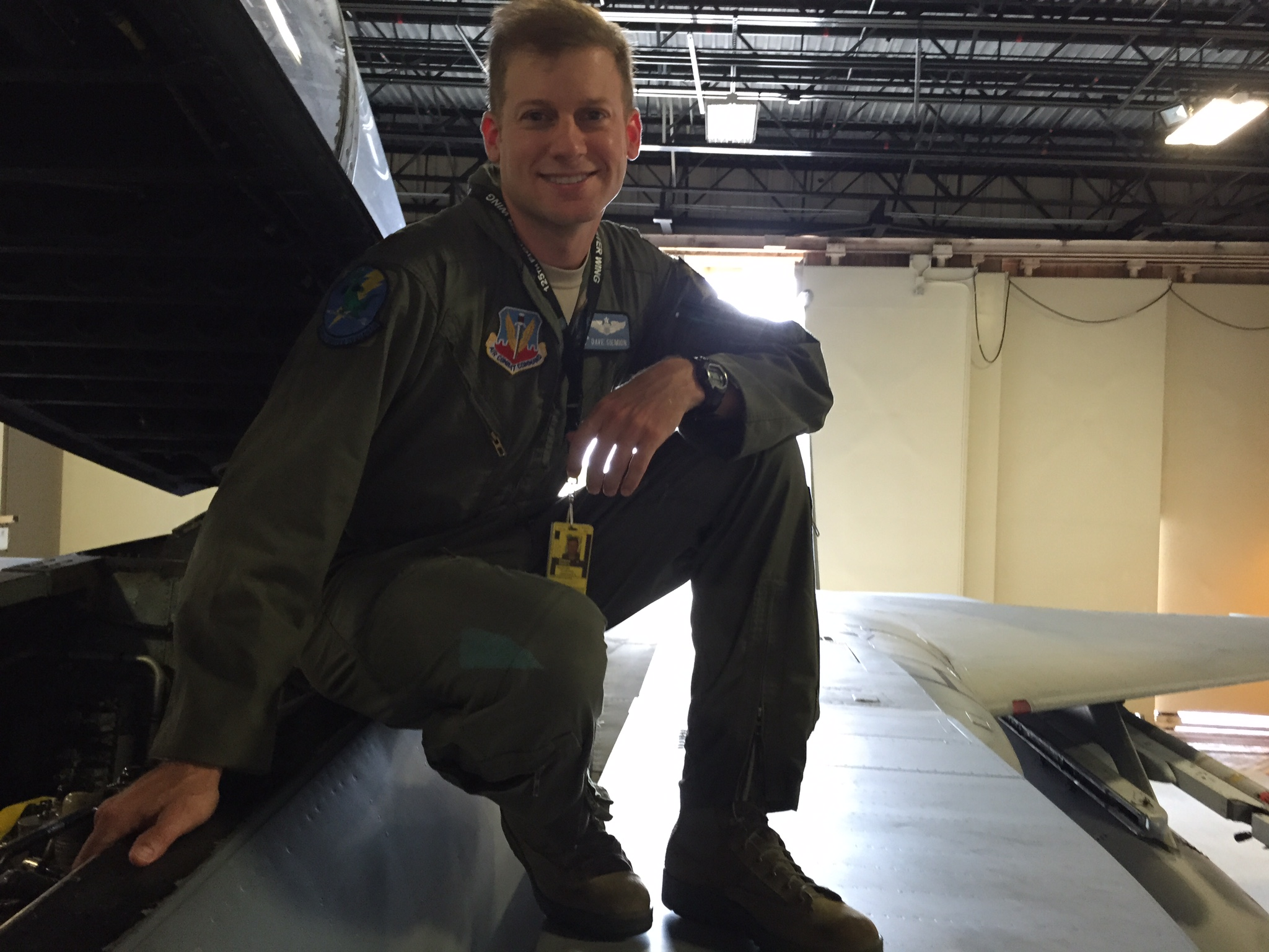 David S., a pilot, sitting on top of a plane